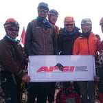 On top of carstensz pyramid with Indonesia Mountain Guide Flag