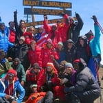 With the group of clients to the top of Africa 19341ft above the sea level.