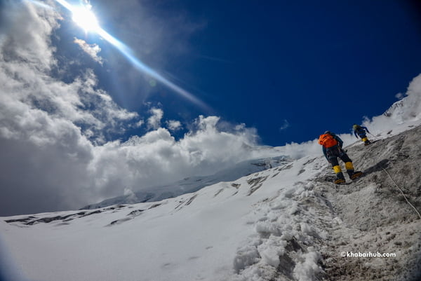 Sherpas fix rope upto Camp III on Mt Manaslu